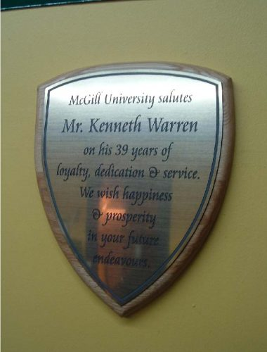 mcgill plaque engraved brushed gold plaque on wood background