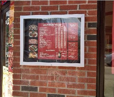 restaurant Atlas Pizza illuminated outdoor menu box