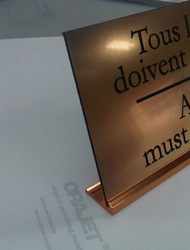 brushed gold engraved sign with gold desk slider